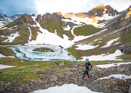 Anna Frost makes her way past Island lakes in the snow splashed mountains of San Juan. Photo Mike Trappe