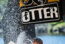 Marc Lauenstein Otter finish line champagne