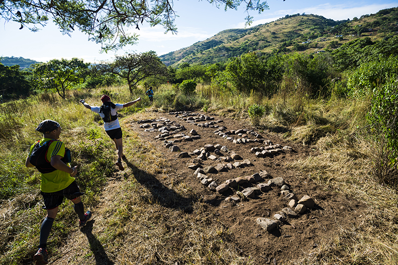 Sizwe, one of the Molweni trail builders, got inspired and created this rock sign along the course. photo Anthony Grote