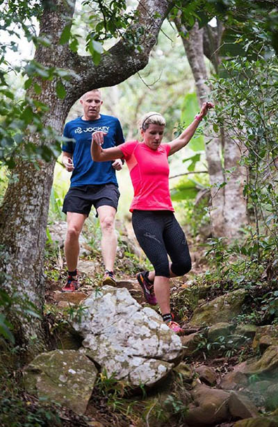 Robyn Greyling chased by Alan Phillips at Molweni Trail Run 2016 by Anthony grote