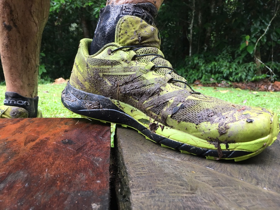 Salomon Sense Ride Cuyabeno Ecuador Amazon muddy front view one shoe on wooden step 6684 website 950pixels